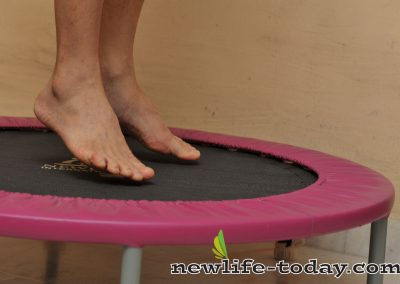 Person jumping on rebounder trampoline newlife international